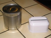 A steel can prepared for used safety razor storage.  You can also purchase a razor bank (right).