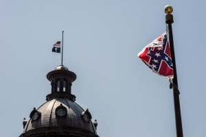 Columbia, South Carolina. As the US and state flags fly at half-mast in mourning, the Confederate flag flies at full mast. (Sean Rayford/Getty Images)